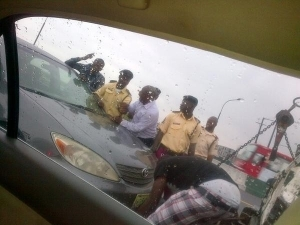 See How This LASTMA Official Beating Up This Elderly Man At Osborne Bridge Dolphin Estate [See Photo]